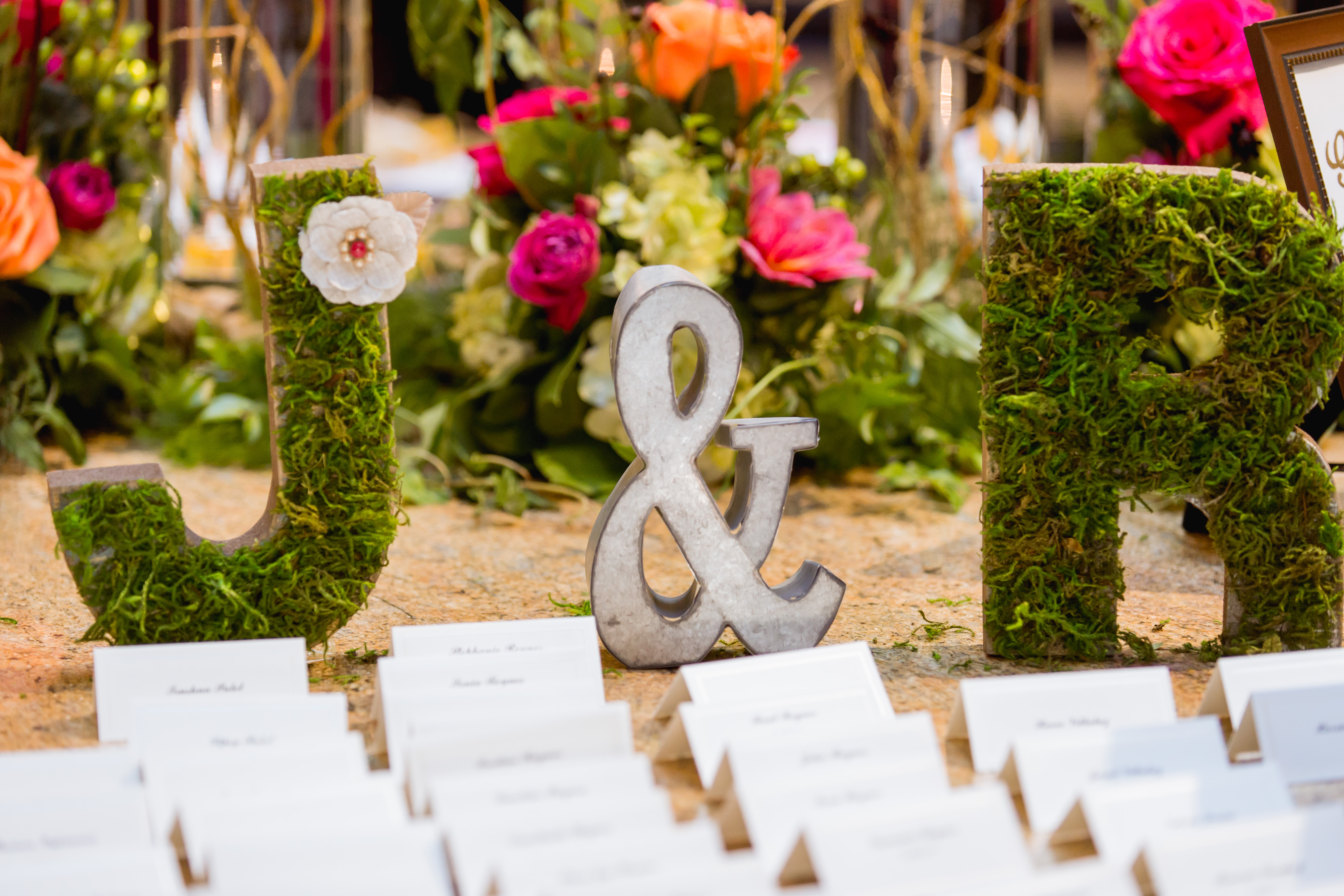 Rustic greenery inspiration for your escort card table! Create a display using your initials made completely from greenery like we did here.