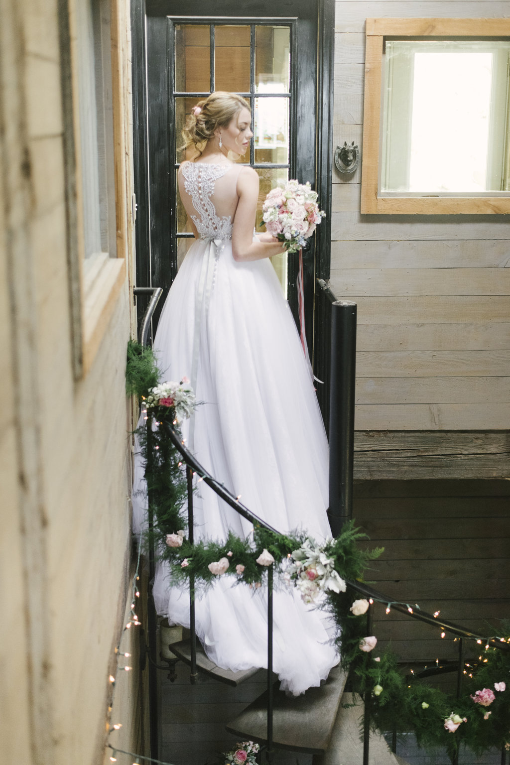 Crazy gorgeous back detail on this rustic chic elegant wedding gown! This dress would be perfect in a ballroom, but we think it looks even better on a country farm!