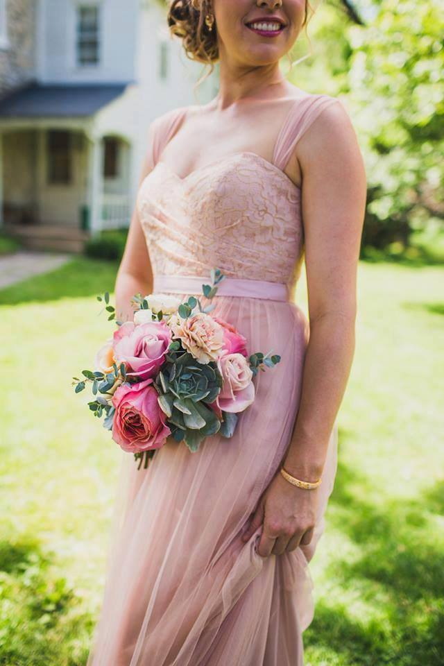 This romantic pale pink chiffon bridesmaid dress is perfect for an outdoor garden wedding. Get this look and more on our blog today!