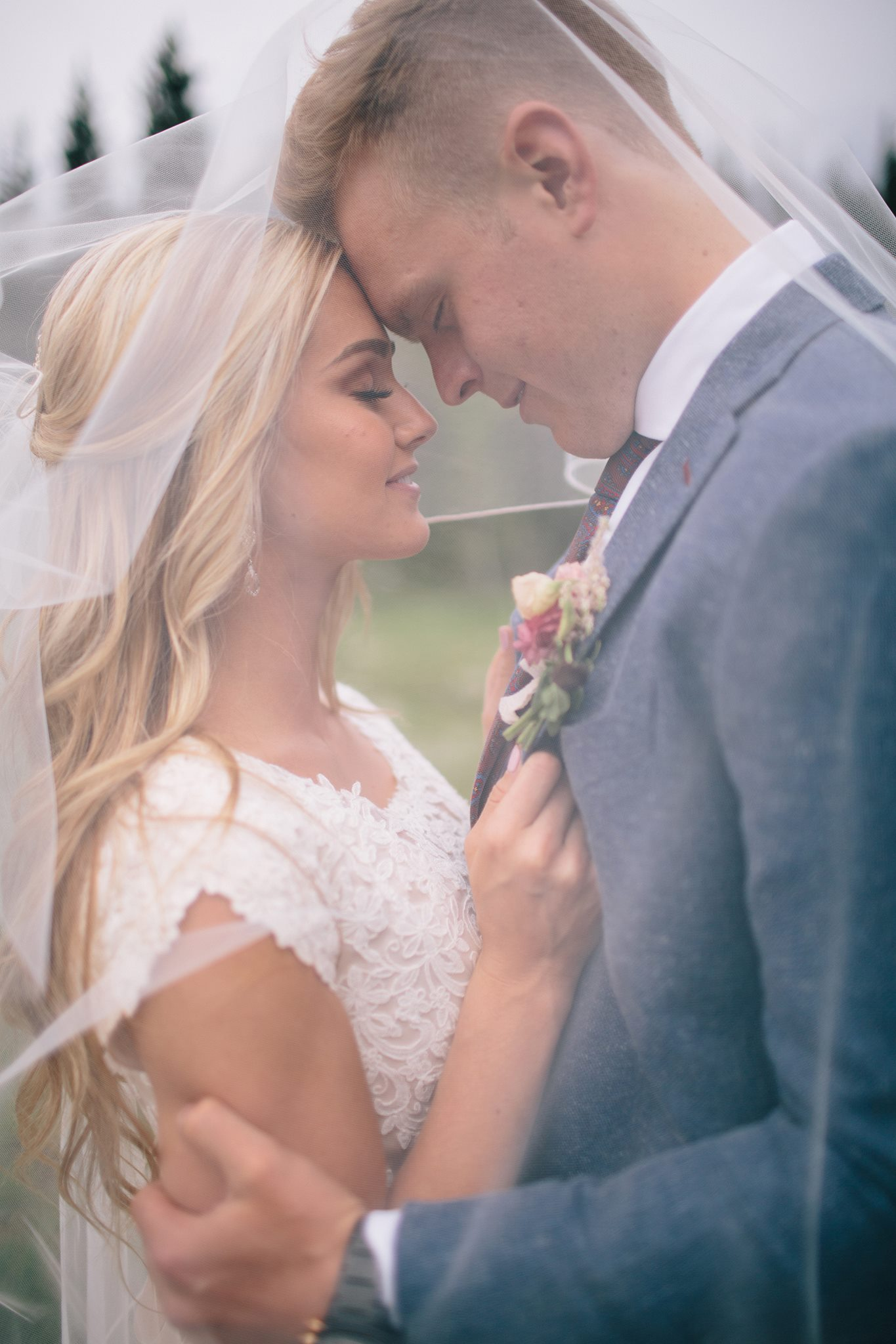Our stunning bride and groom sharing a romantic moment on their wedding day.
