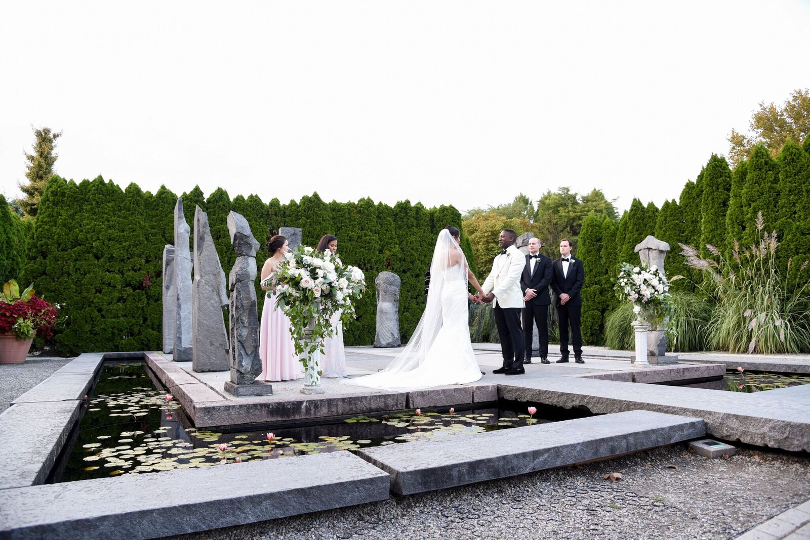 A traditional garden ceremony at Grounds for Sculpture complete with elegant and chic florals in white and green. Read more about this wedding on our blog!