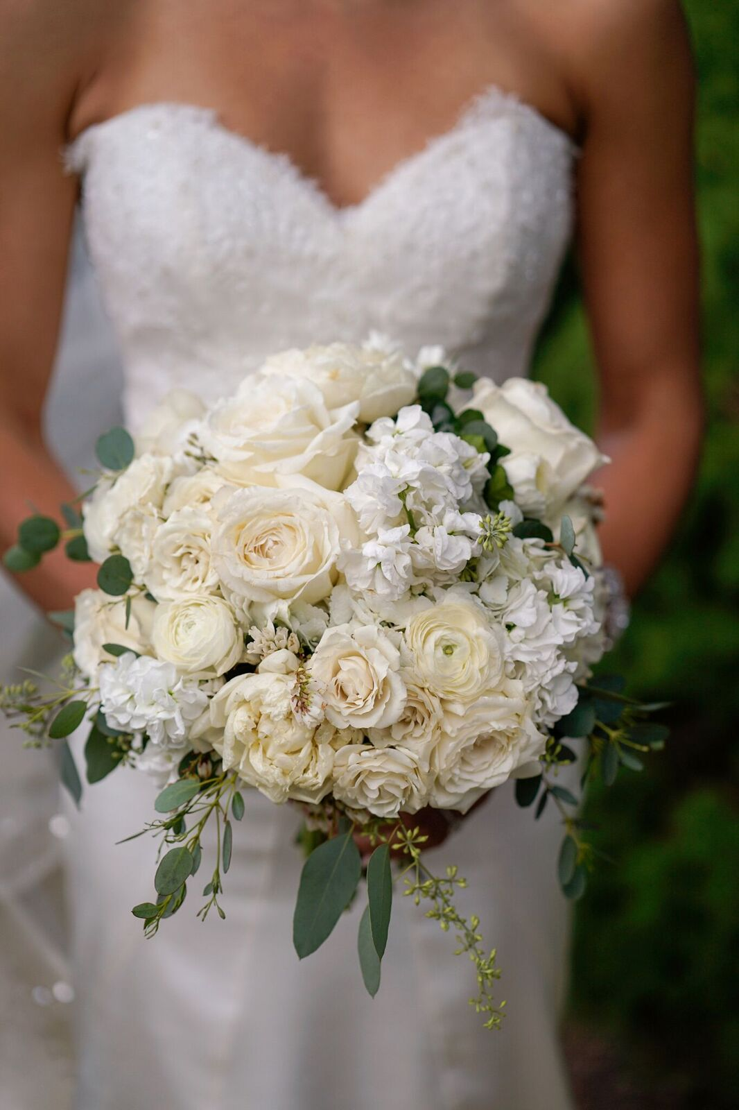 An all white chic bridal bouquet was the perfect look for our gorgeous bride at her garden wedding. Read the blog to see all the details of this amazing Princeton wedding day we planned!