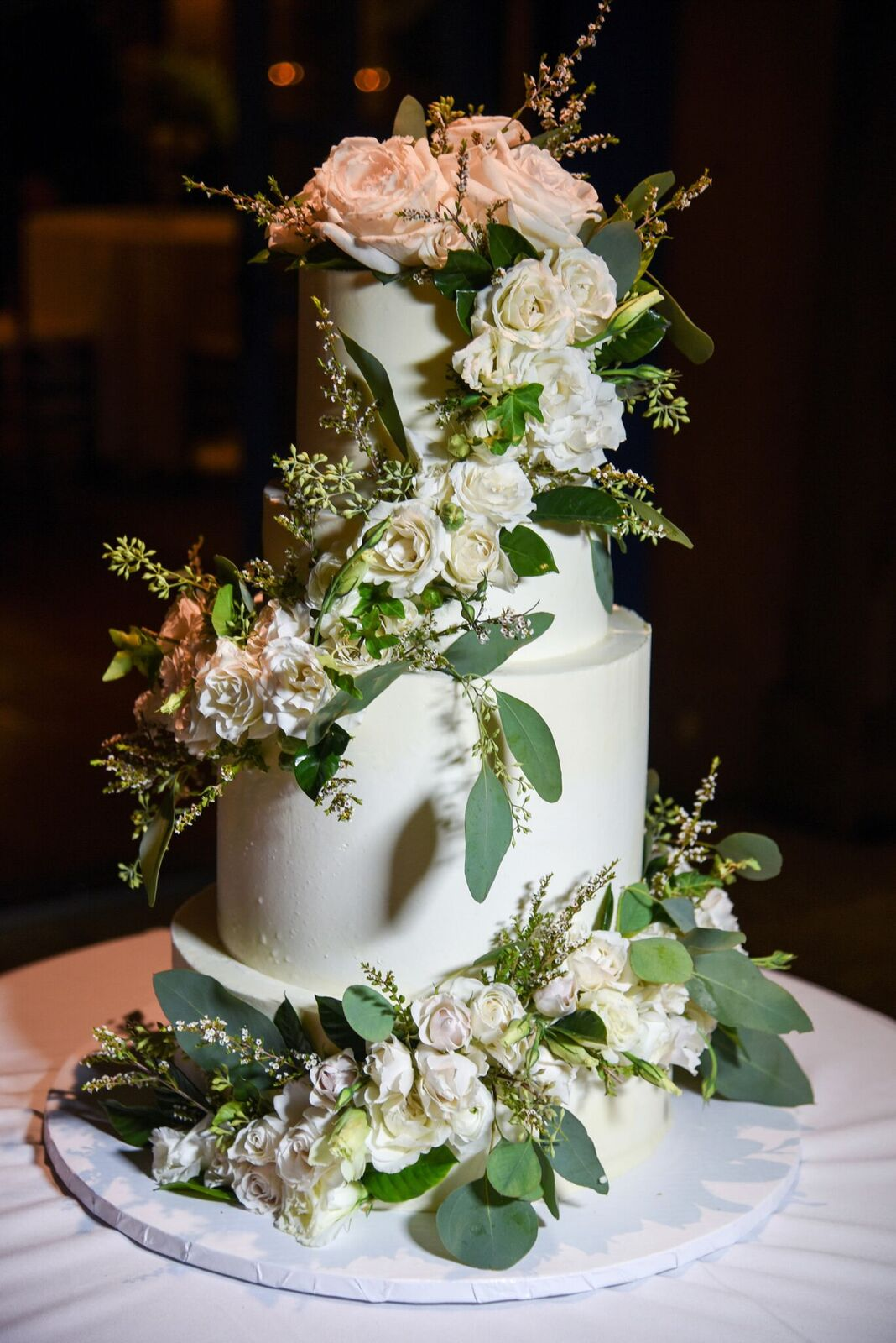 This gorgeous boho chic wedding cake was perfect for a garden summer wedding we planned at Grounds for Sculpture. Check out the white and green details in the blog and get inspired for your own wedding day!