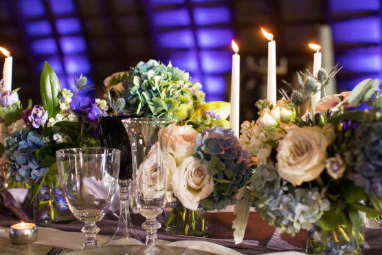 Long wedding table with roses and candles