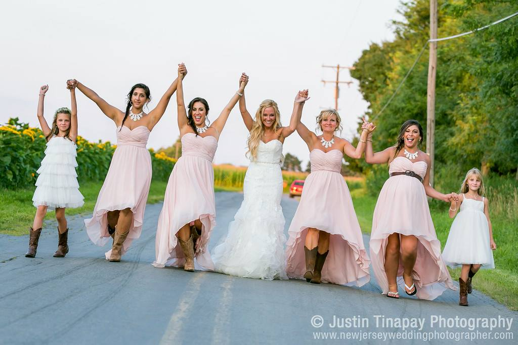 bride and bridesmaids walking down street