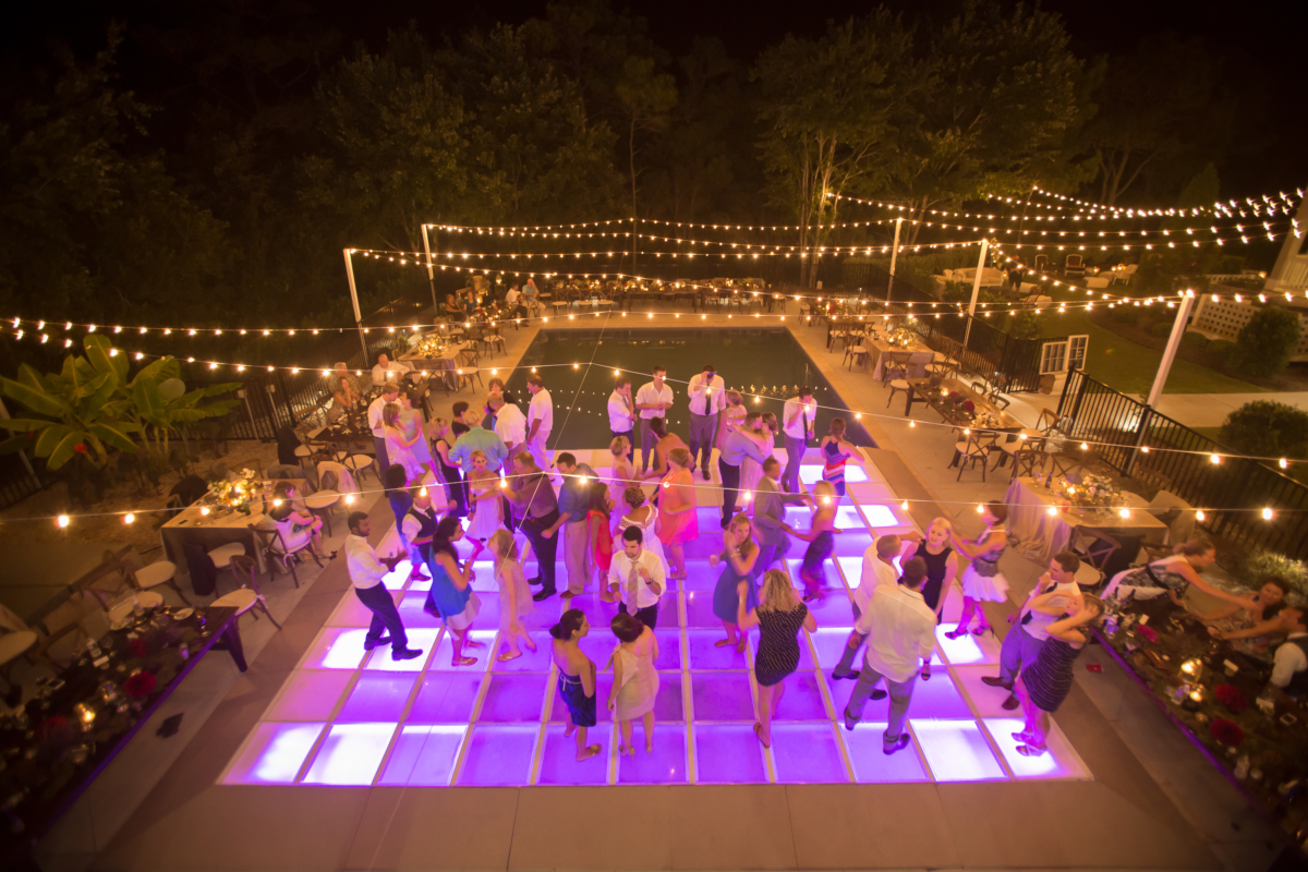 outdoor wedding with pool and dance floor