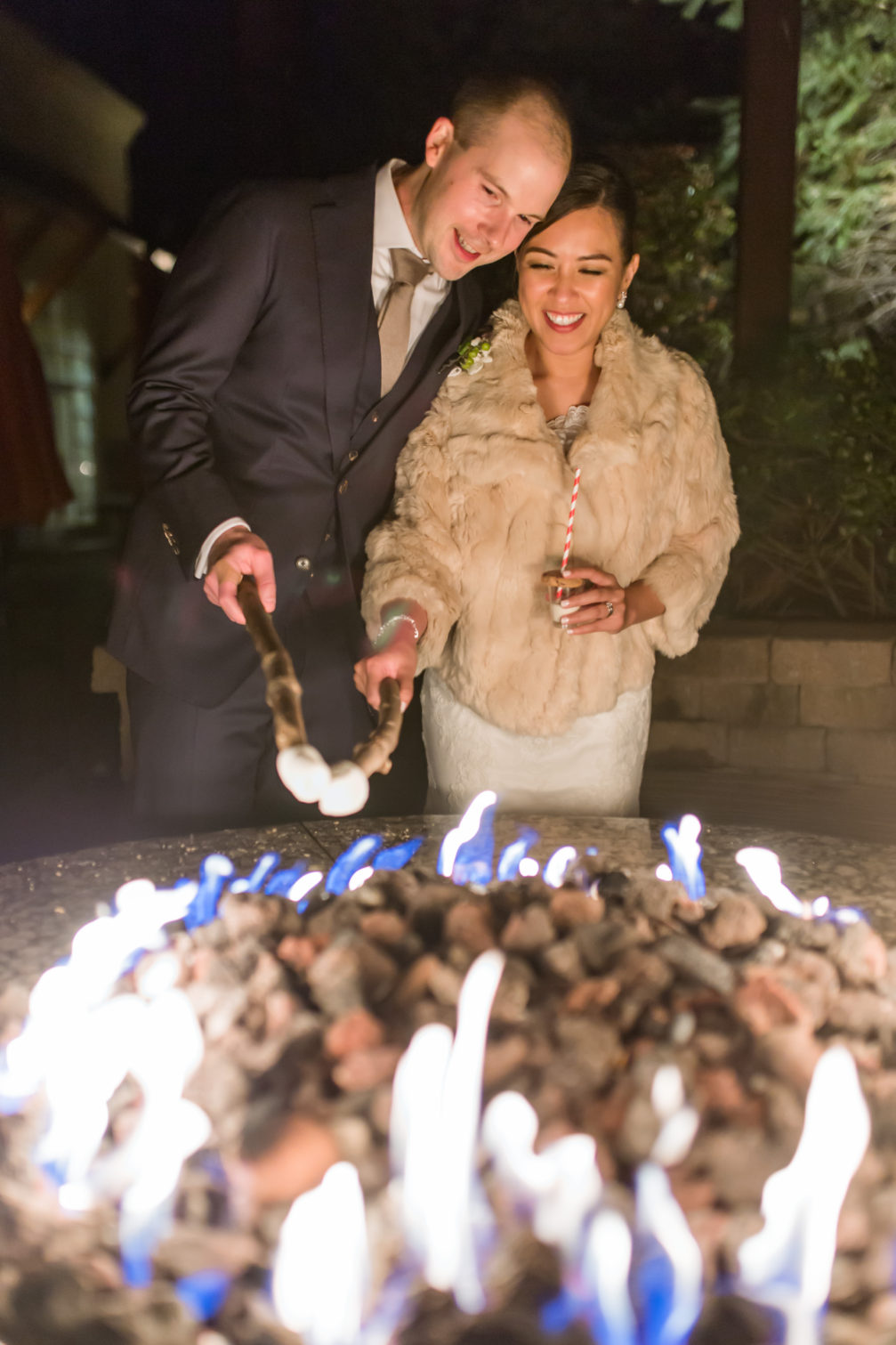 bride and groom roasting smores
