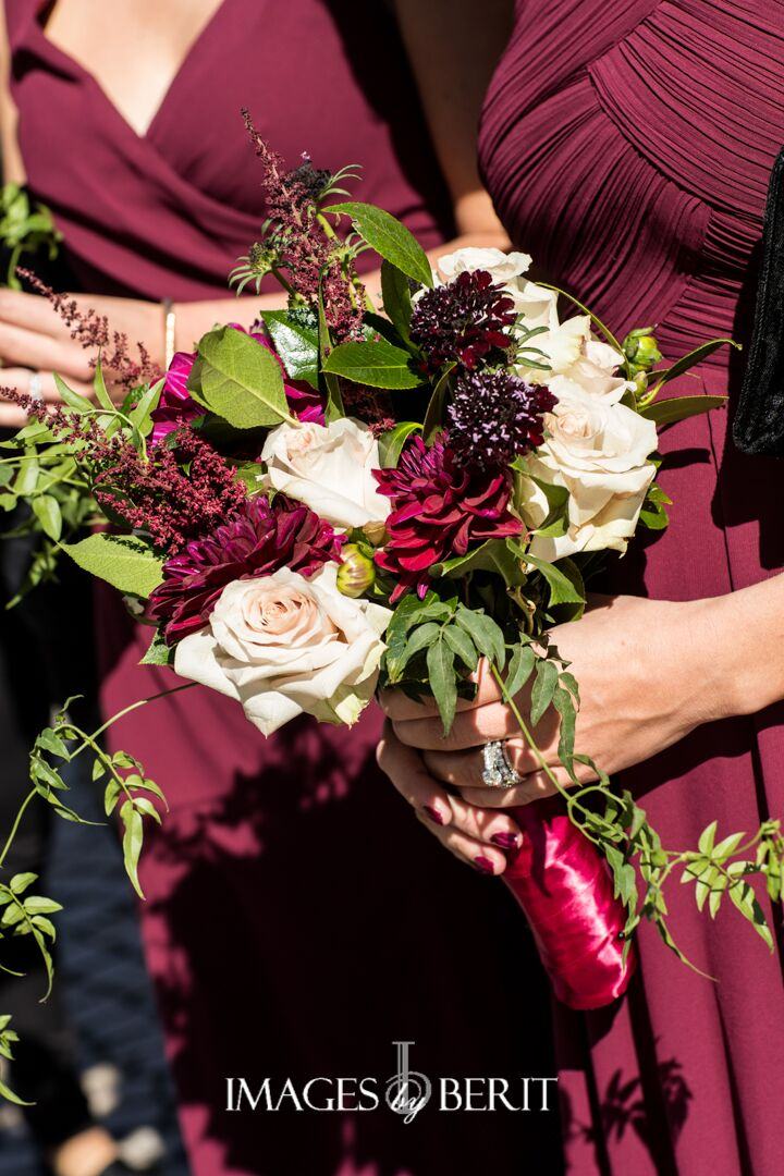 bridesmaids bouquets in deep colors