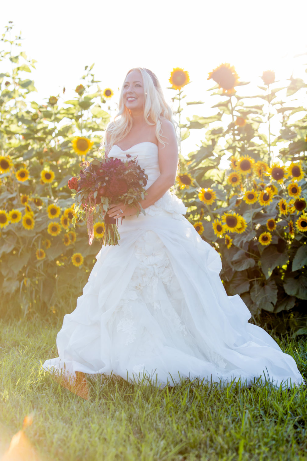 bride with bouquet for outdoor wedding