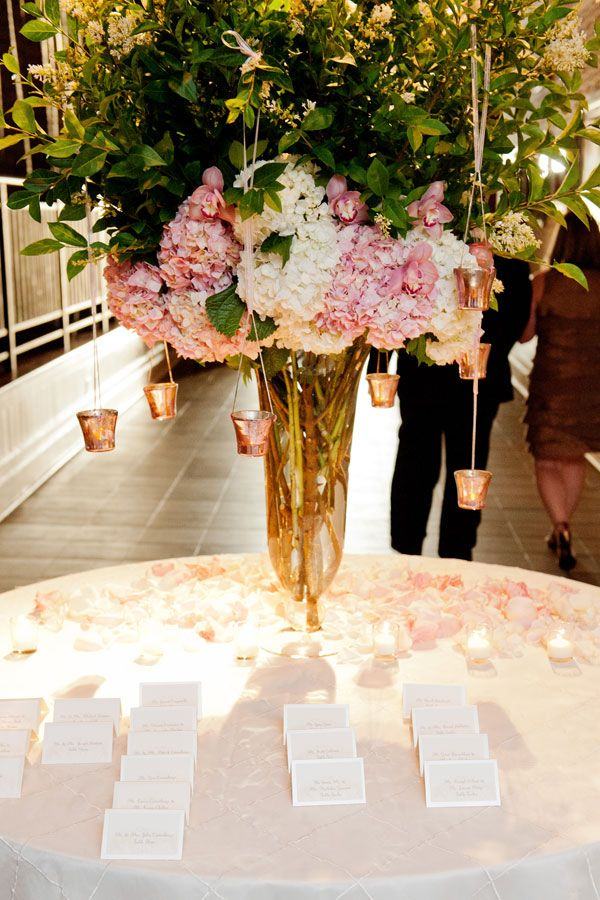 escort card table with greenery at wedding