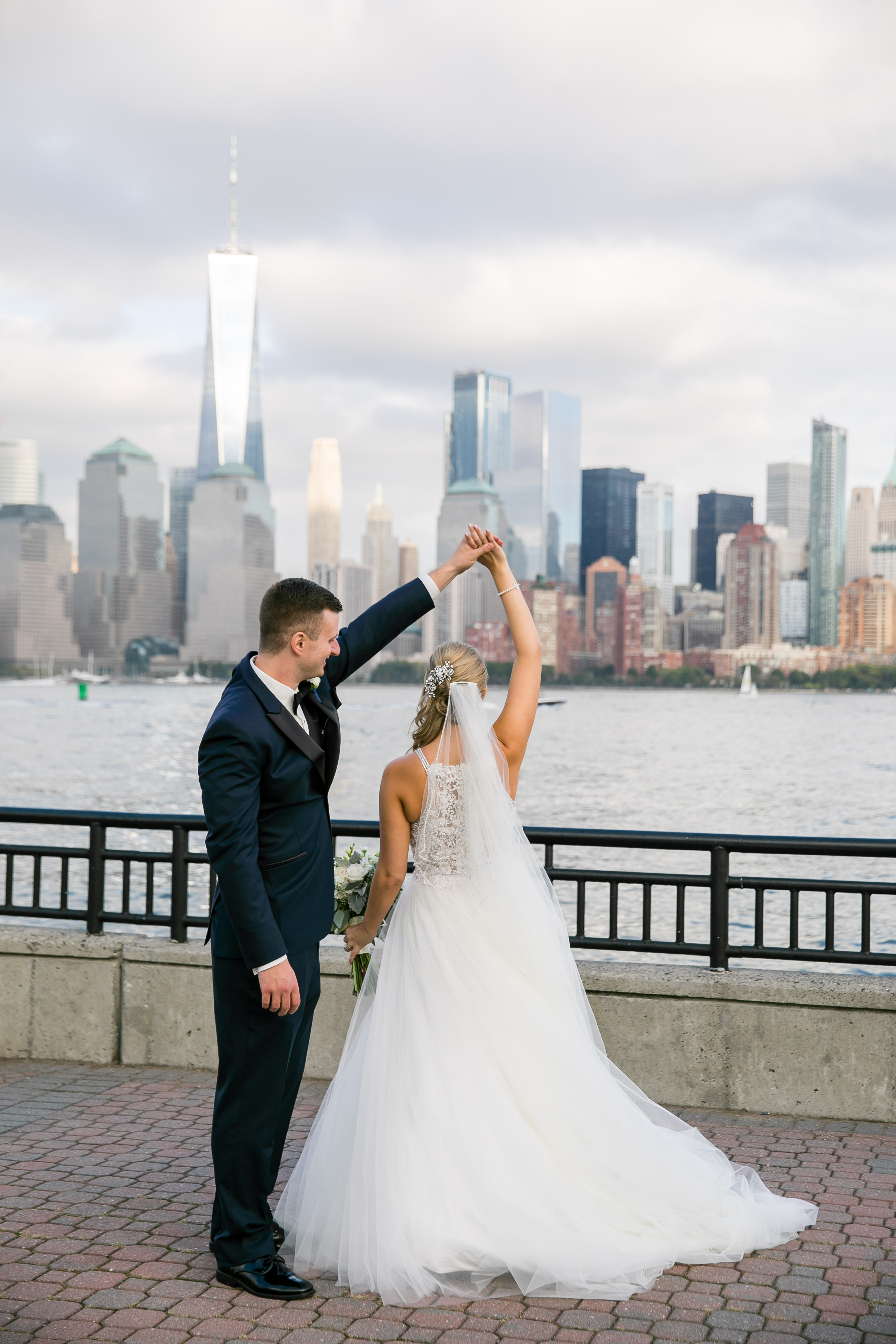 bride and groom twirling in nyc