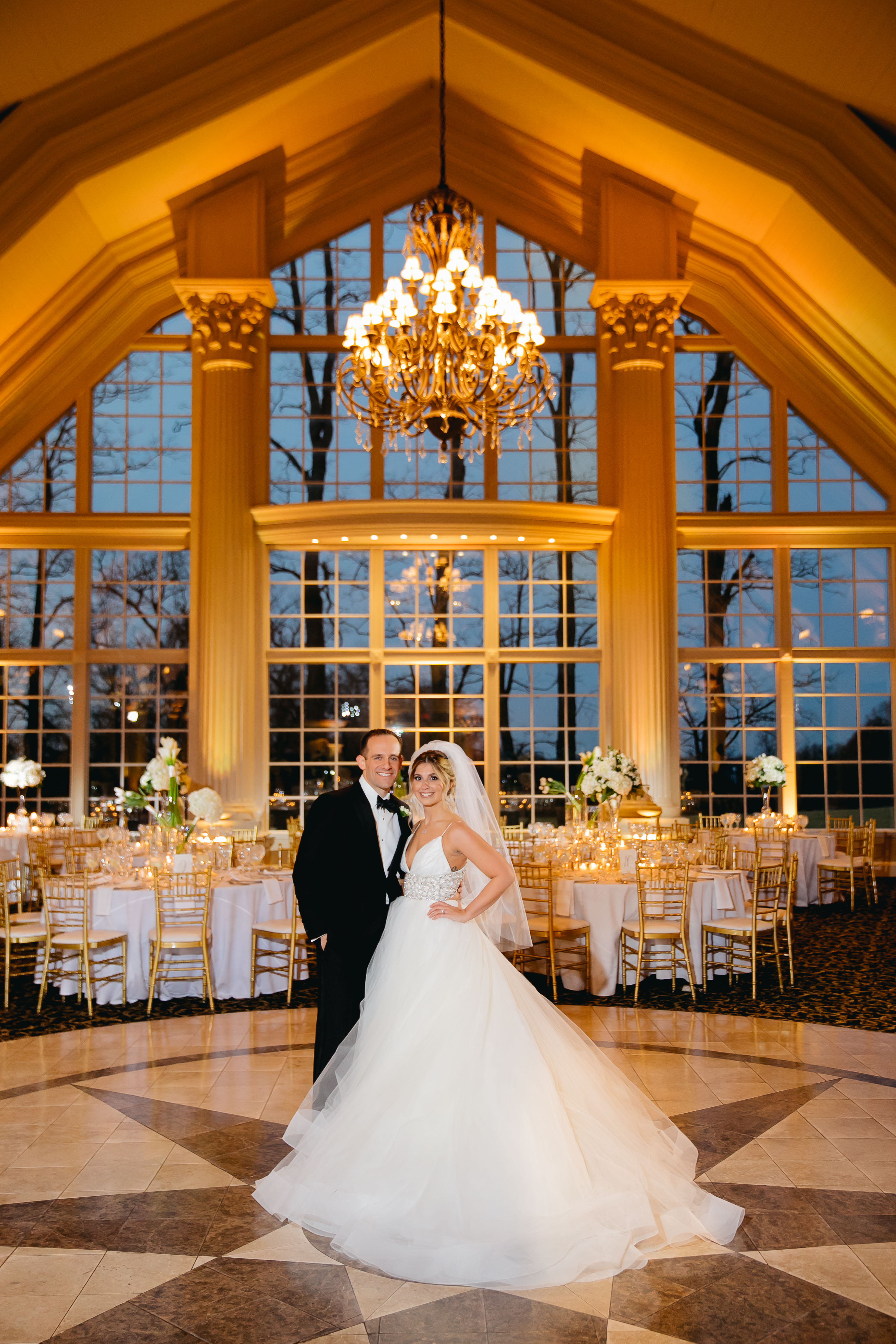 bride and groom inside reception ballroom