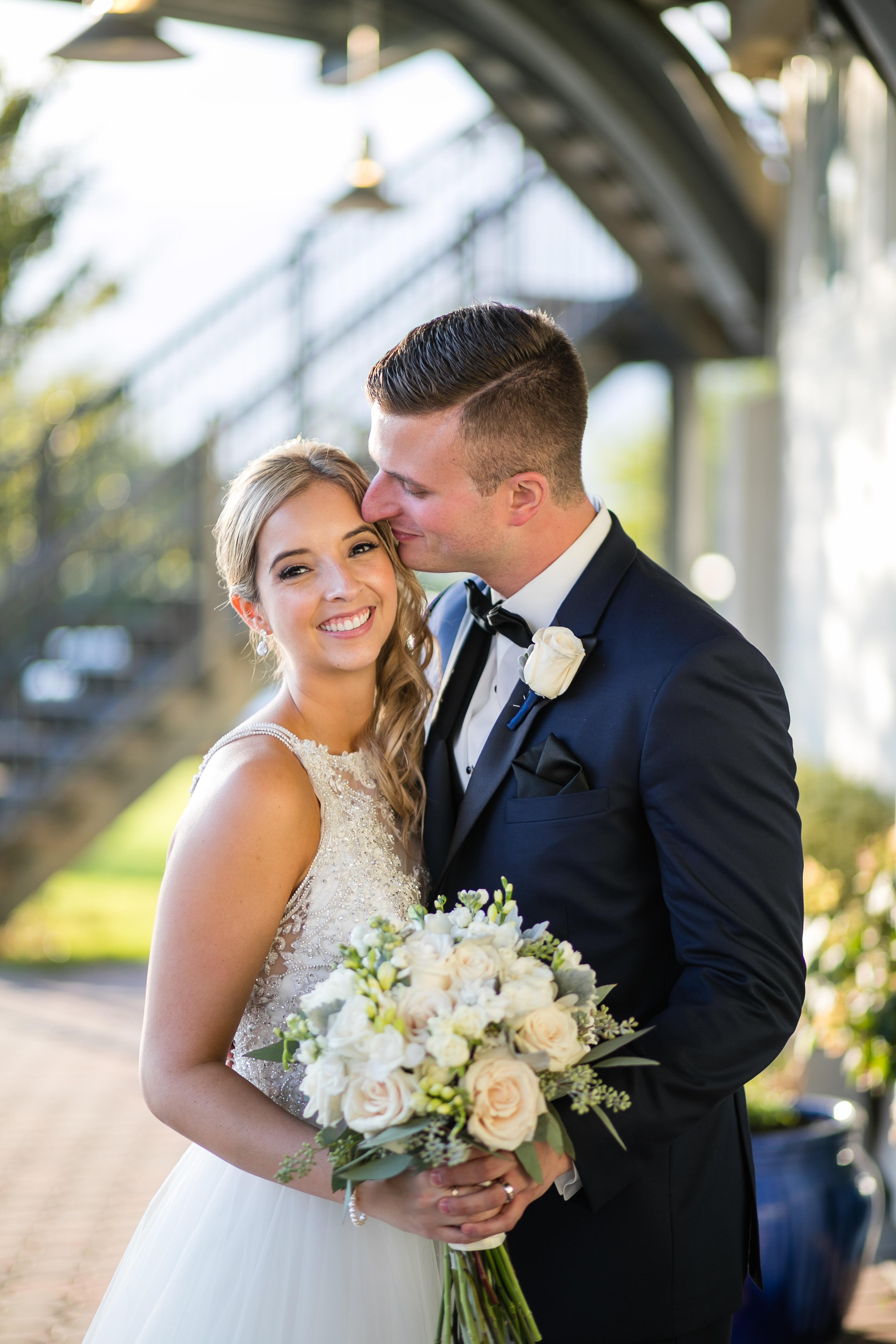 bride getting kissed by groom