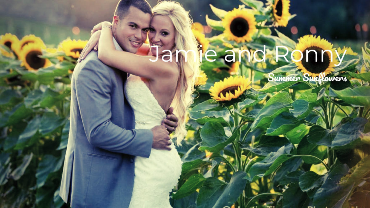 bride and groom embracing in front of sunflowers