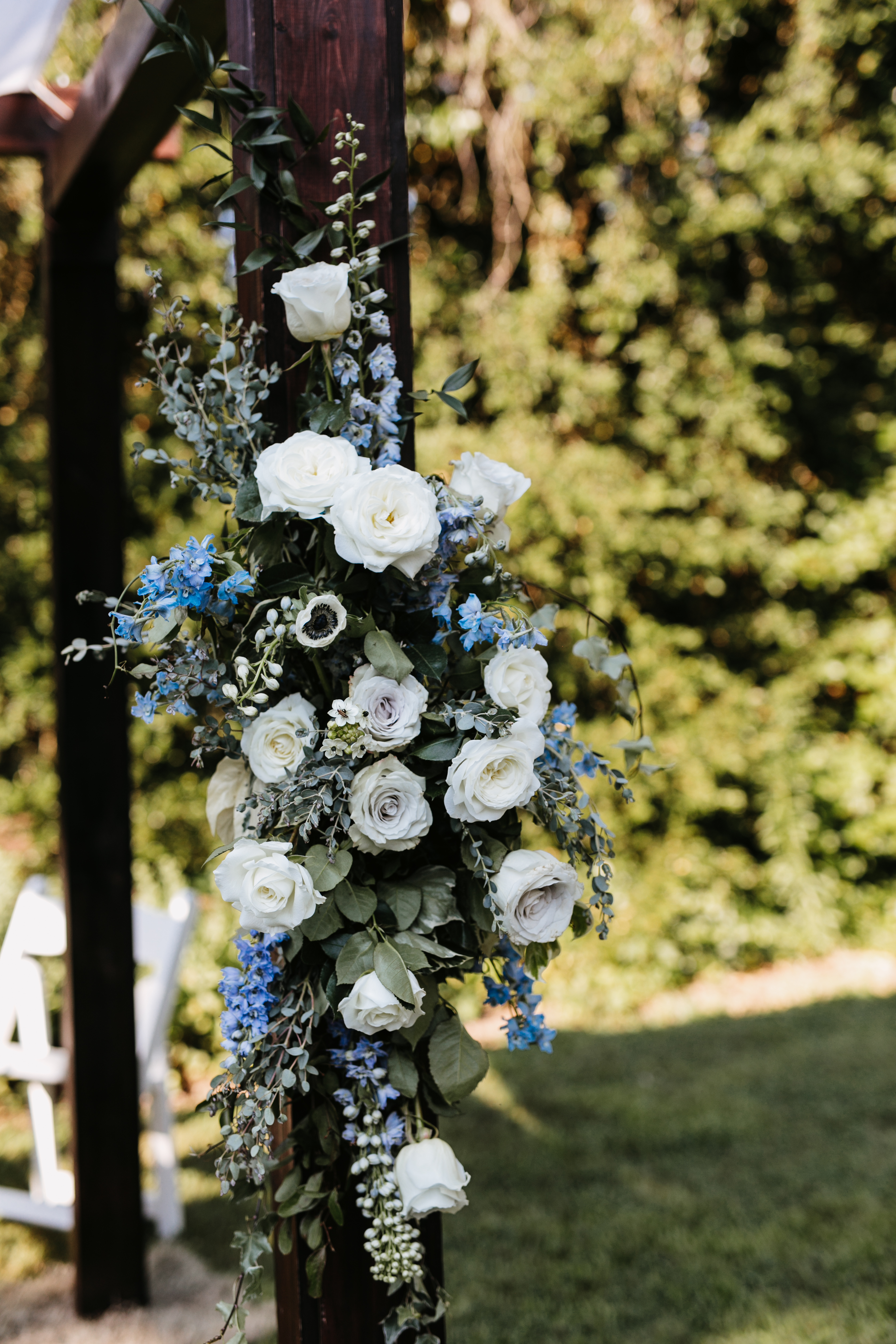 white blue and gray flowers on chuppah