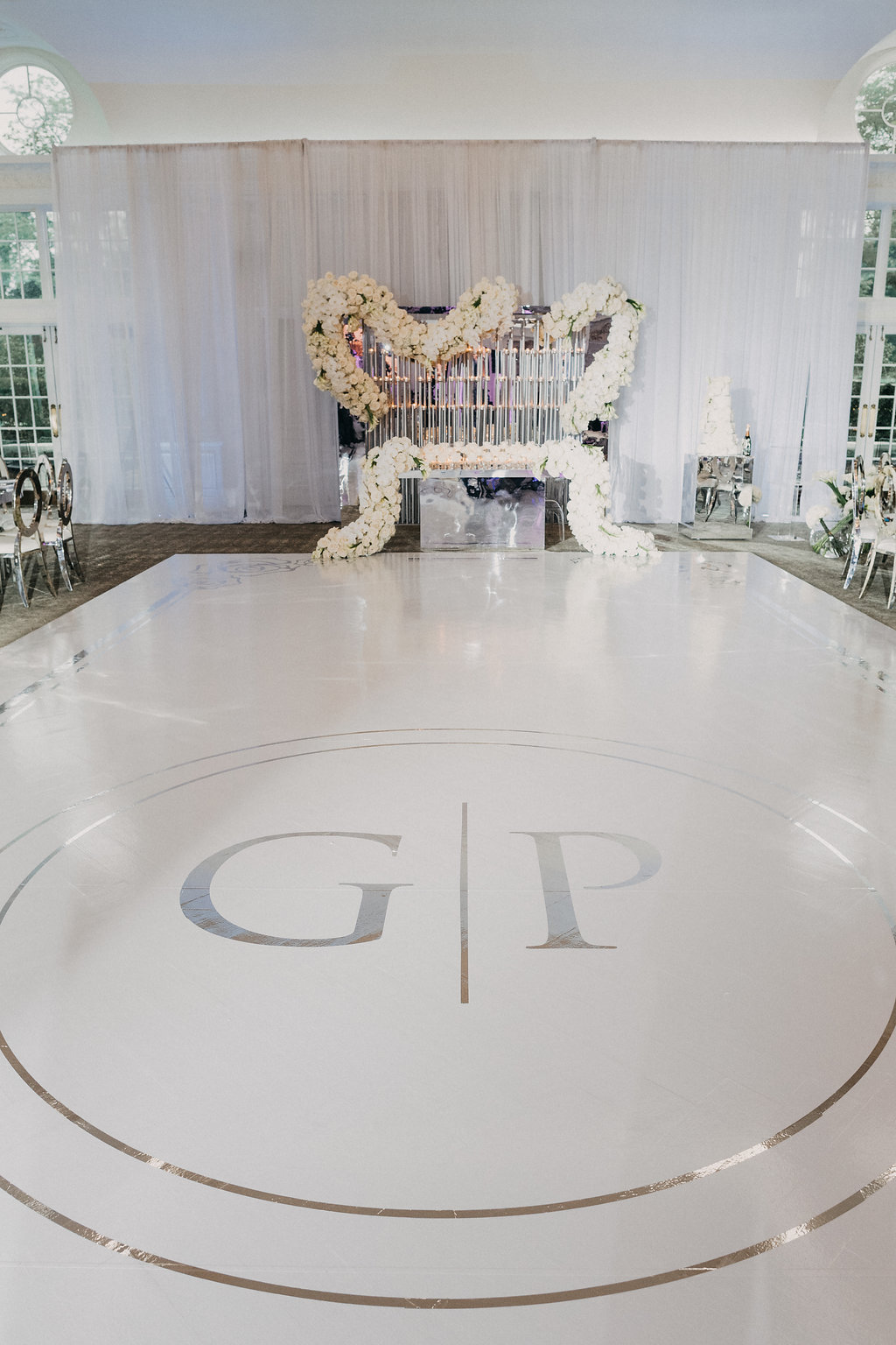 white dance floor with monogram