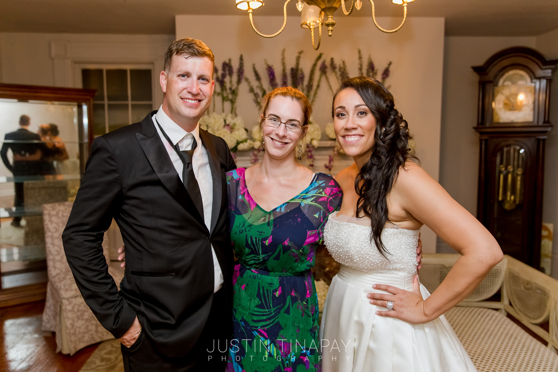 wedding planner posing with bride and groom