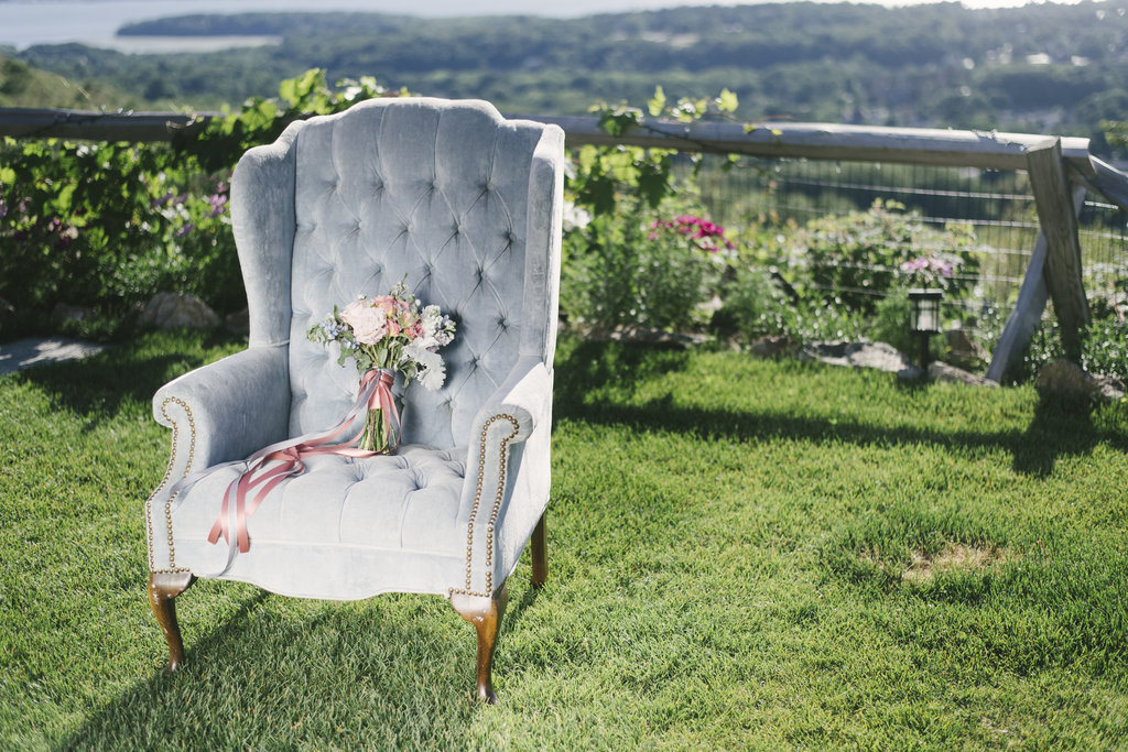 blue chair with pink and white bridal bouquet