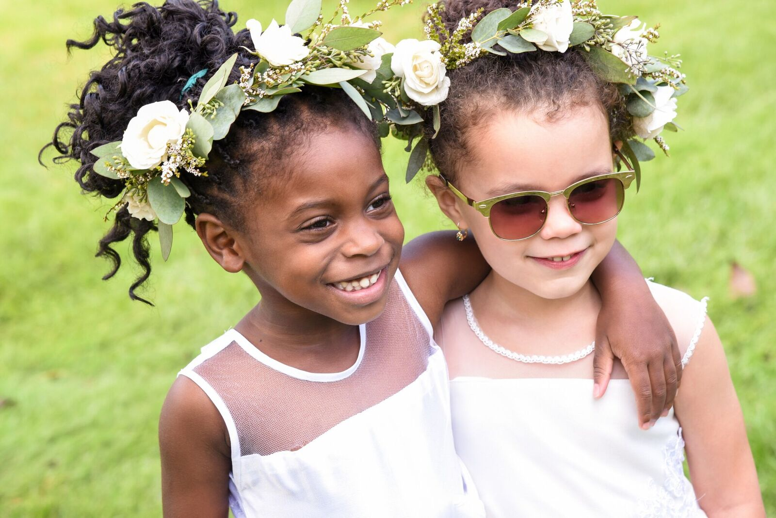 two flower girls with flower crowns