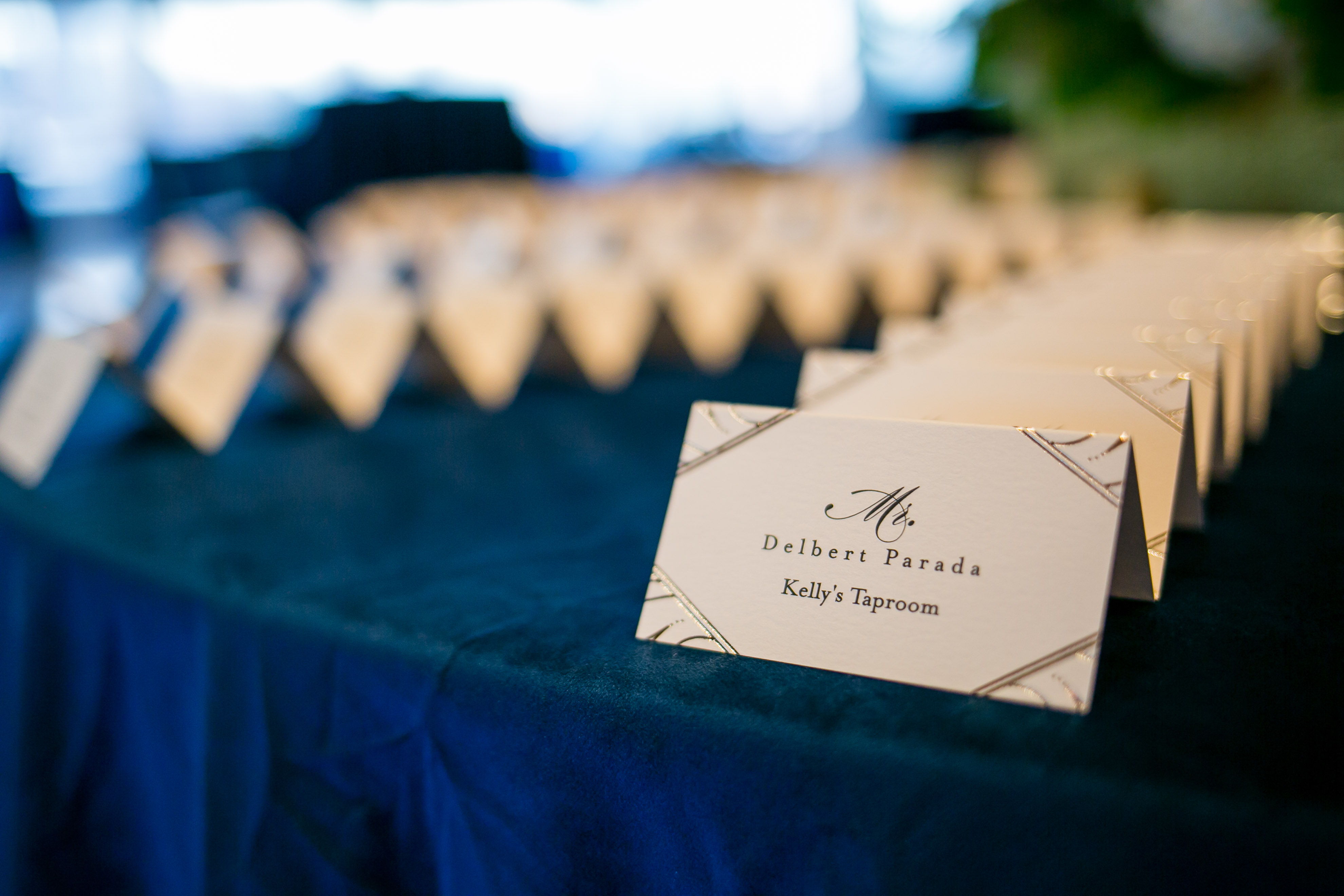 cream escort cards with gold details