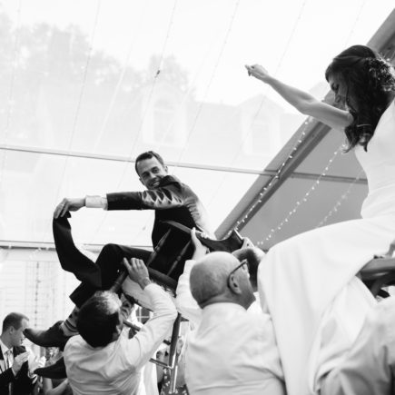 bride and groom lifted up for hora