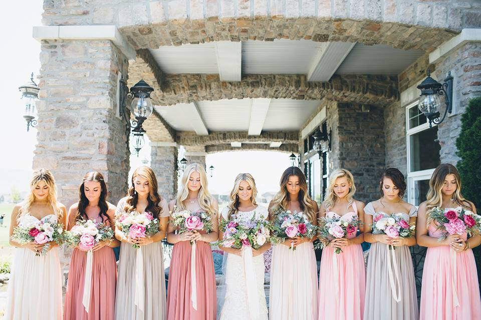bridesmaids in ombre pink dresses