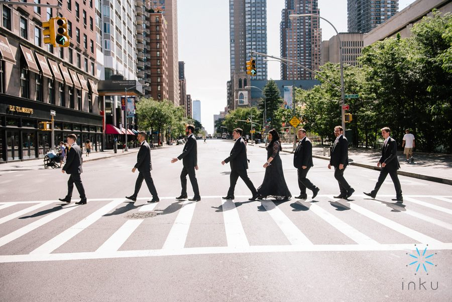 picture of groomsmen walking across the street beatles style