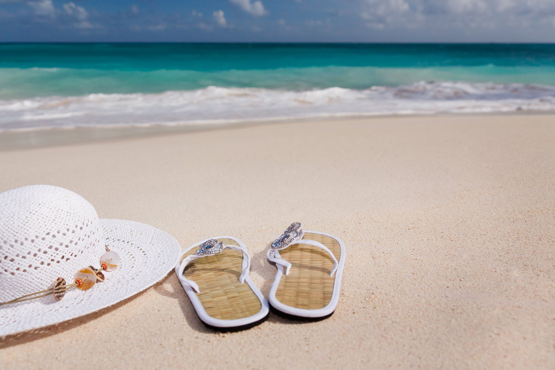 beach sandals and hat