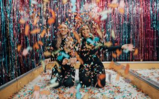 two girls in confetti