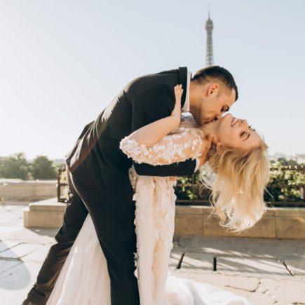 groom kissing bride in paris