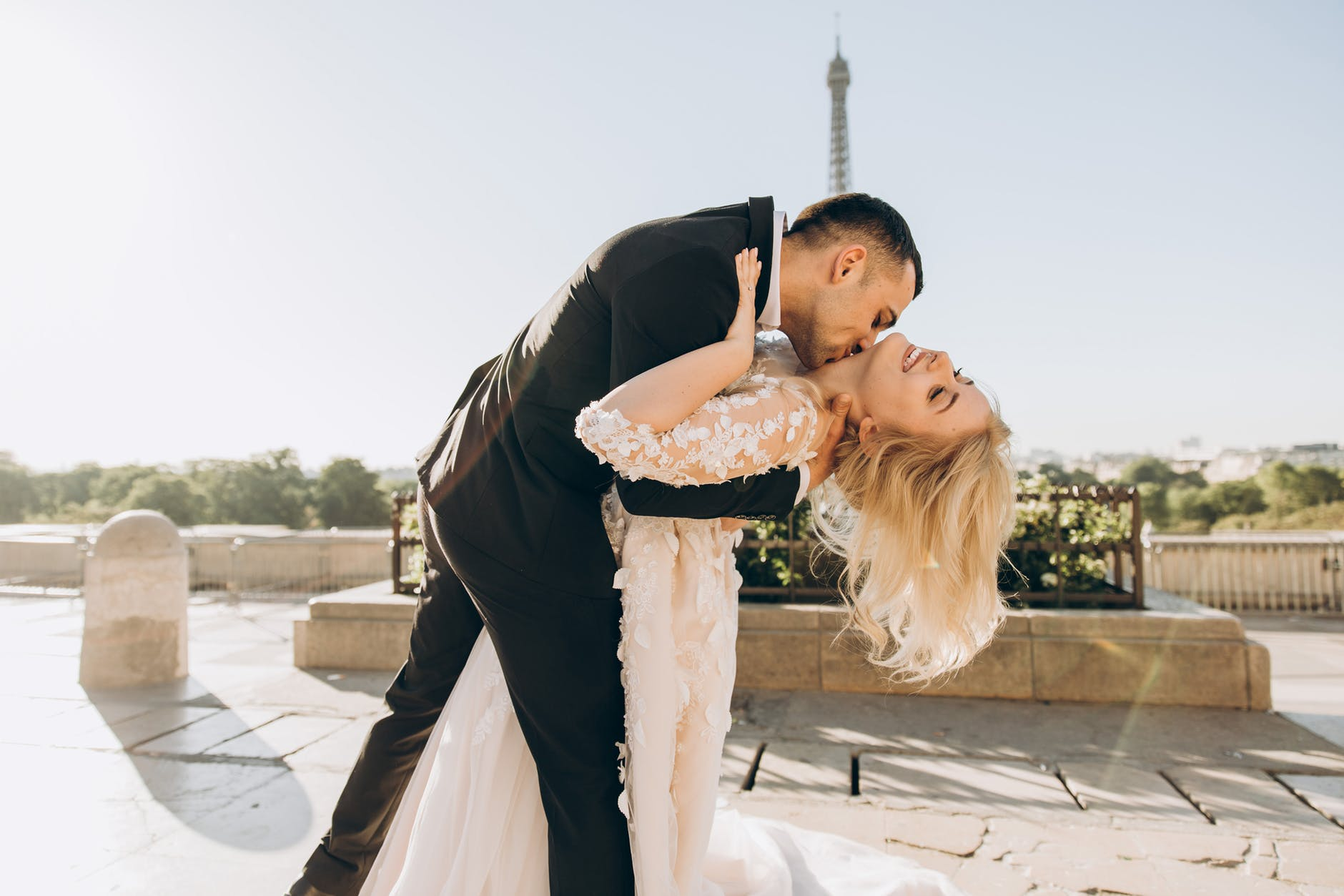 groom kissing bride in paris