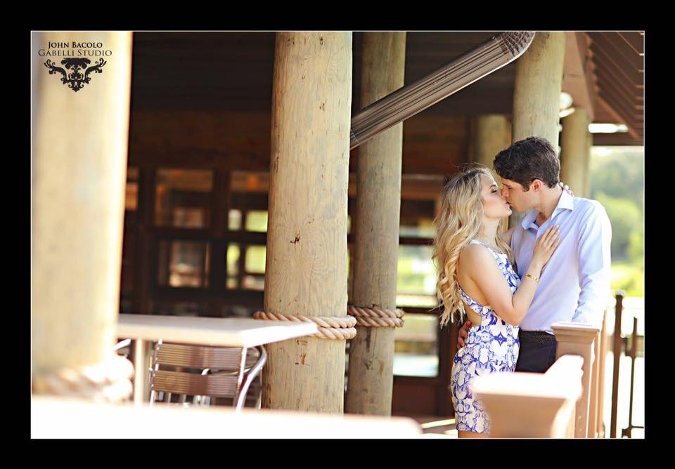 engagement session photo of couple kissing
