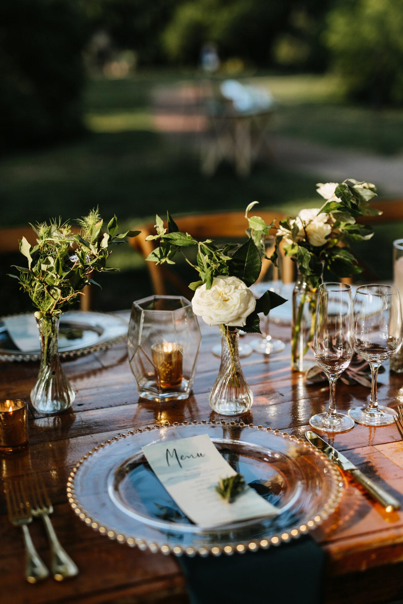 place setting at long table at farm wedding