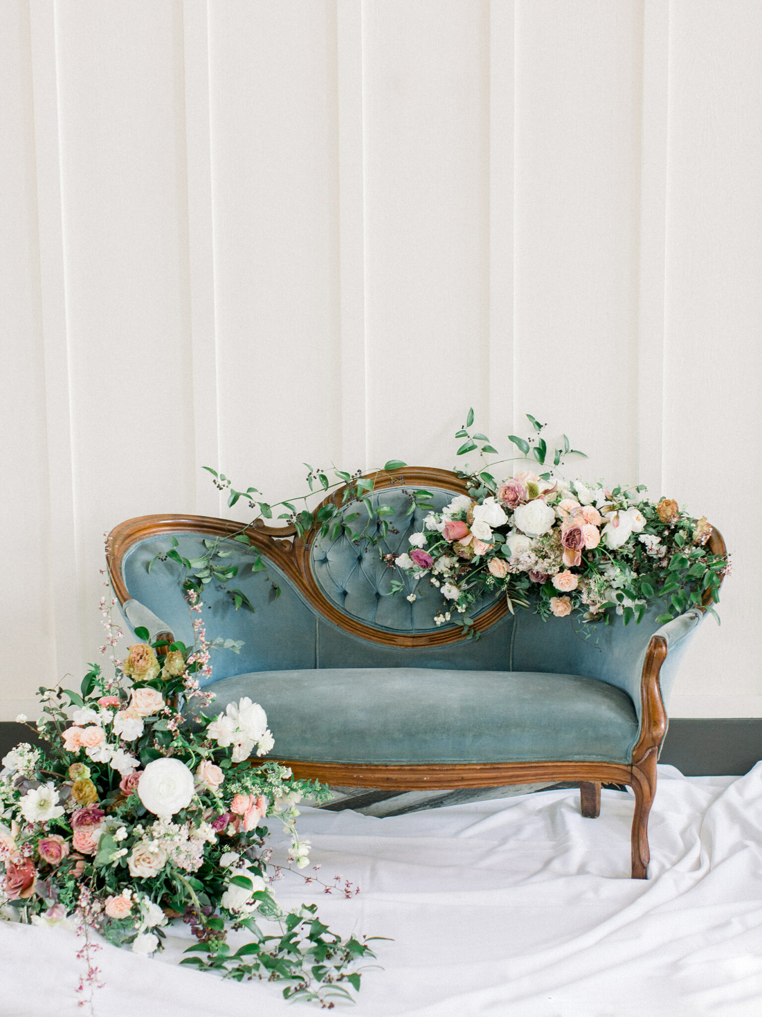 dusty blue vintage couch covered in flowers