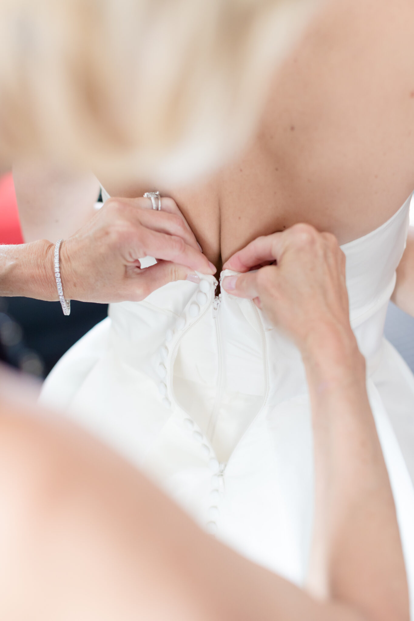 bride getting zipped up
