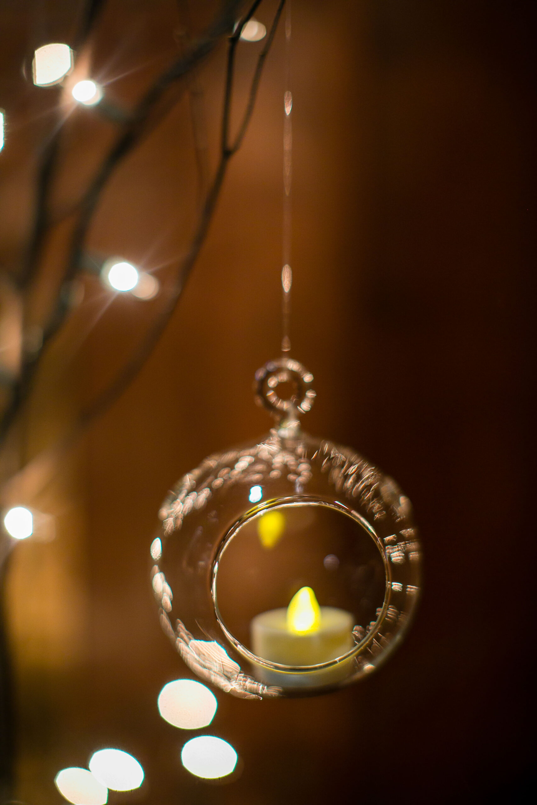 candle in glass hanging ball