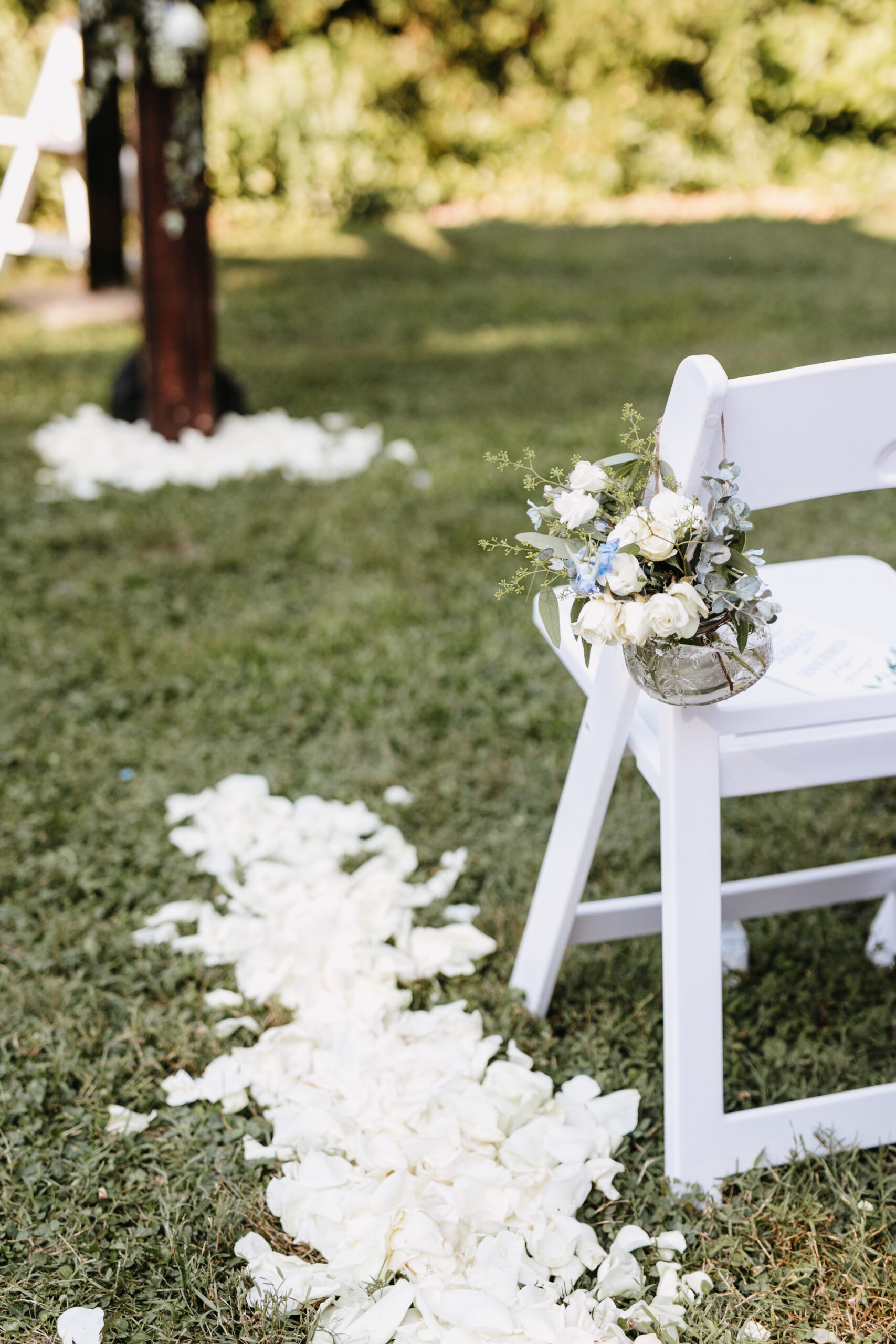 wedding ceremony chair with rose petals