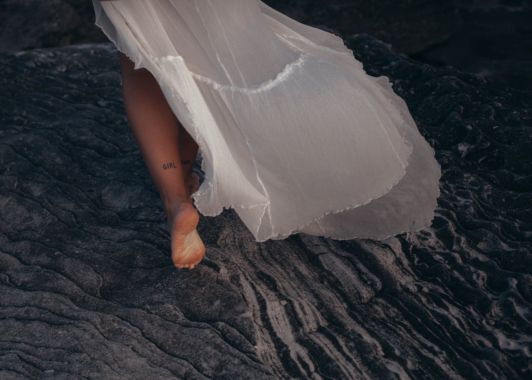 bride running with bare feet