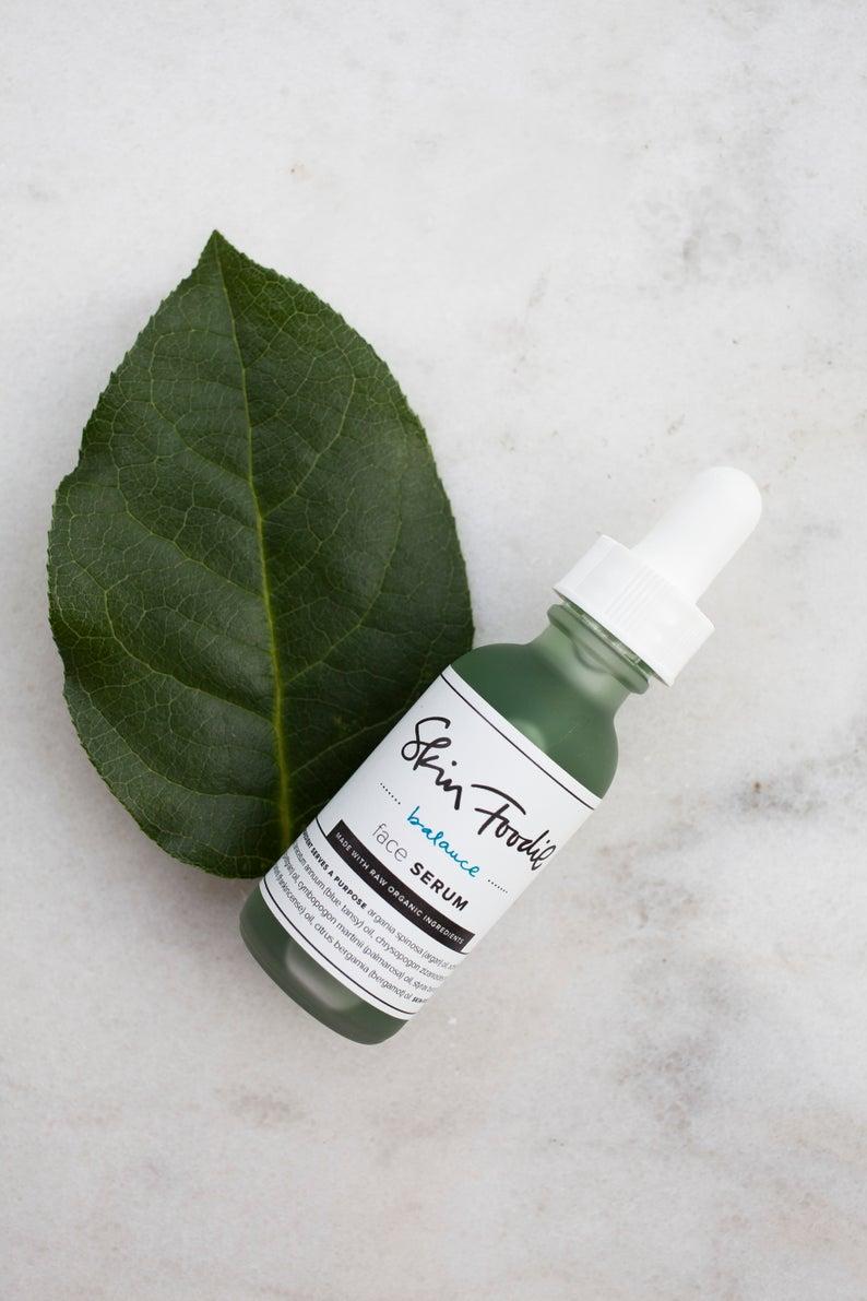 facial serum and leaf