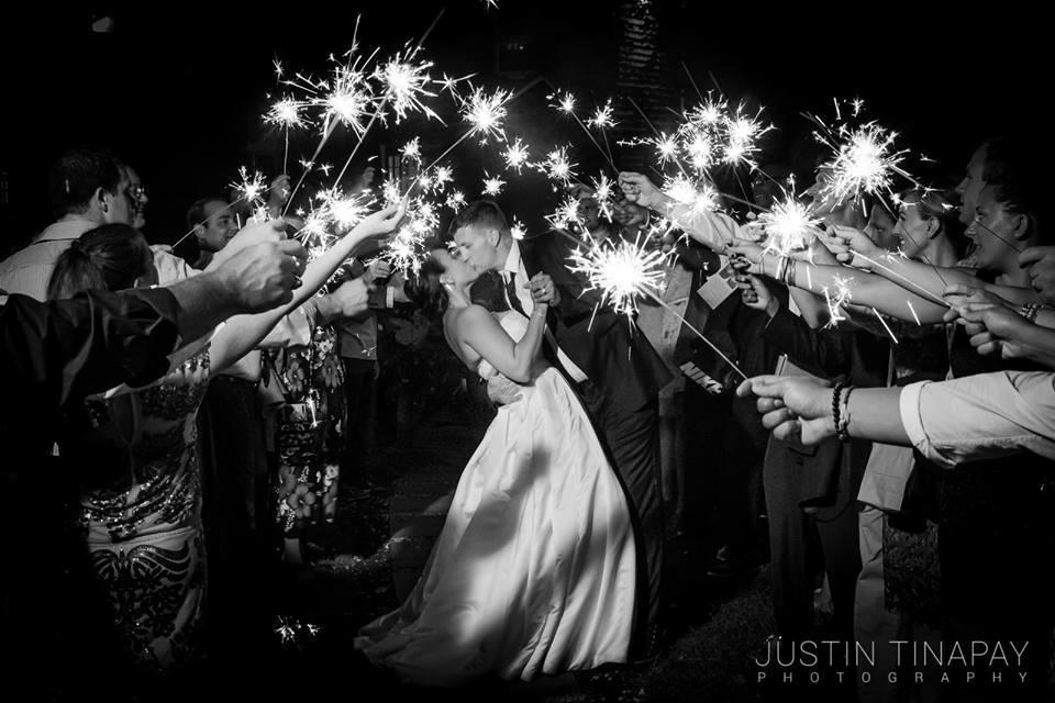 bride and groom inside sparkler exit