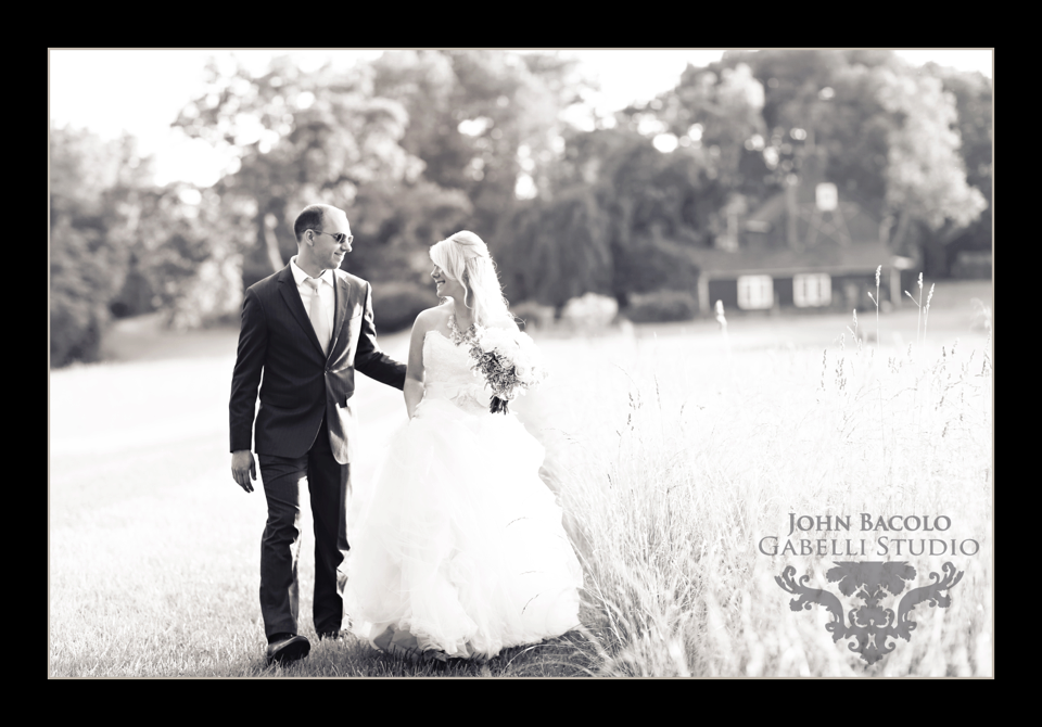 bride and groom hand in hand black and white photo