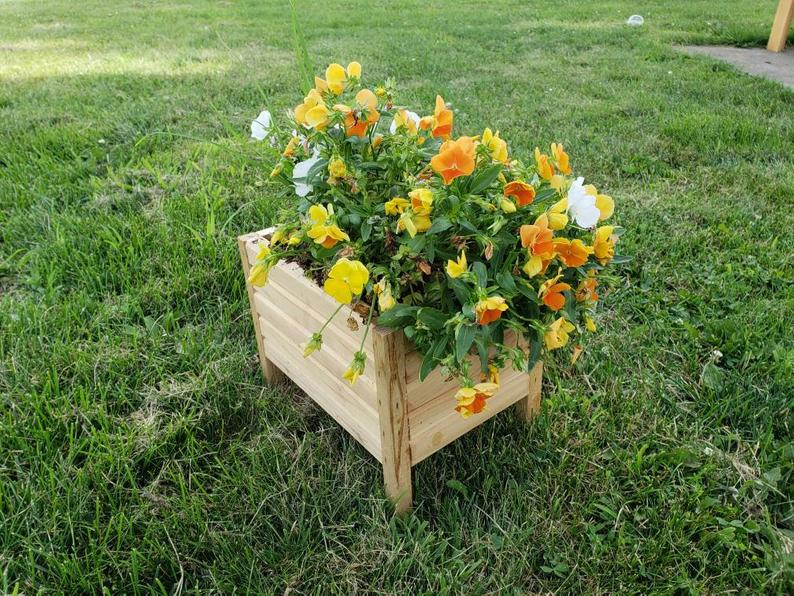 elevated garden box with flowers